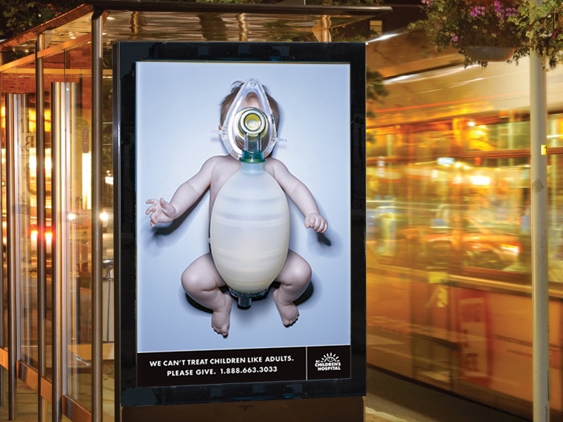 Photo of bus station advert showing a child with breathing mask.